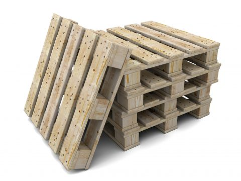 Stack of wooden pallets. One pallet near